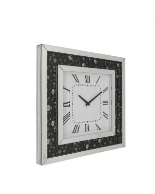 Mirrored wall clock with black backing and floating crystal