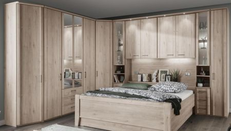 WIEMANN LUXOR Combination 7 Doors Hinged Wardrobe in Holm Oak Finish . Combination Unit10 with 50 cm occasional elements, 3 drawers at bottom, open compartment with clear glass doors.