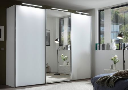 STAUD Satino Sensa 3 Door Sliding Wardrobe with Decor White Carcase and Front in Alpine White Glass with Mirrored middle Door.
