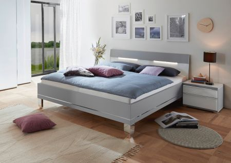 STAUD Sinfonie Plus Bed with White Glass and Light Grey Frame.